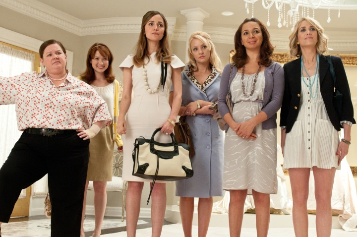 """(L to R) MELISSA MCCARTHY, ELLIE KEMPER, ROSE BYRNE, WENDI MCLENDON-COVEY, MAYA RUDOLPH and KRISTEN WIIG in """"Bridesmaids"""", from producer Judd Apatow.  In the comedy, Wiig leads the cast as Annie, a maid of honor whose life unravels as she leads a group of colorful bridesmaids on a wild ride down the road to matrimony."""