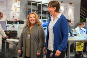 SPY - 2015 FILM STILL - Pictured: Susan Cooper (Melissa McCarthy) and Nancy B. Artingstall (Miranda Hart) marvel at the wonders of a CIA lab - Photo Credit: Larry Horricks © 2015 Twentieth Century Fox. All Rights Reserved. Not for sale or duplication.